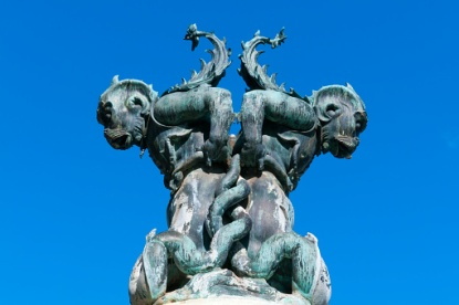 Fountain of sea monsters against blue sky, Piazza SS Annunziata, Firenze, Tuscany, Italy